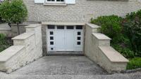 Menuisier poseur et vendeur j'ai réalisé la vente et la pose d'une porte de garage pour l'un de mes clients à Falaise