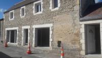 Rénovation d'une maison en pierre par Aubert Menuiserie aux alentours de Falaise